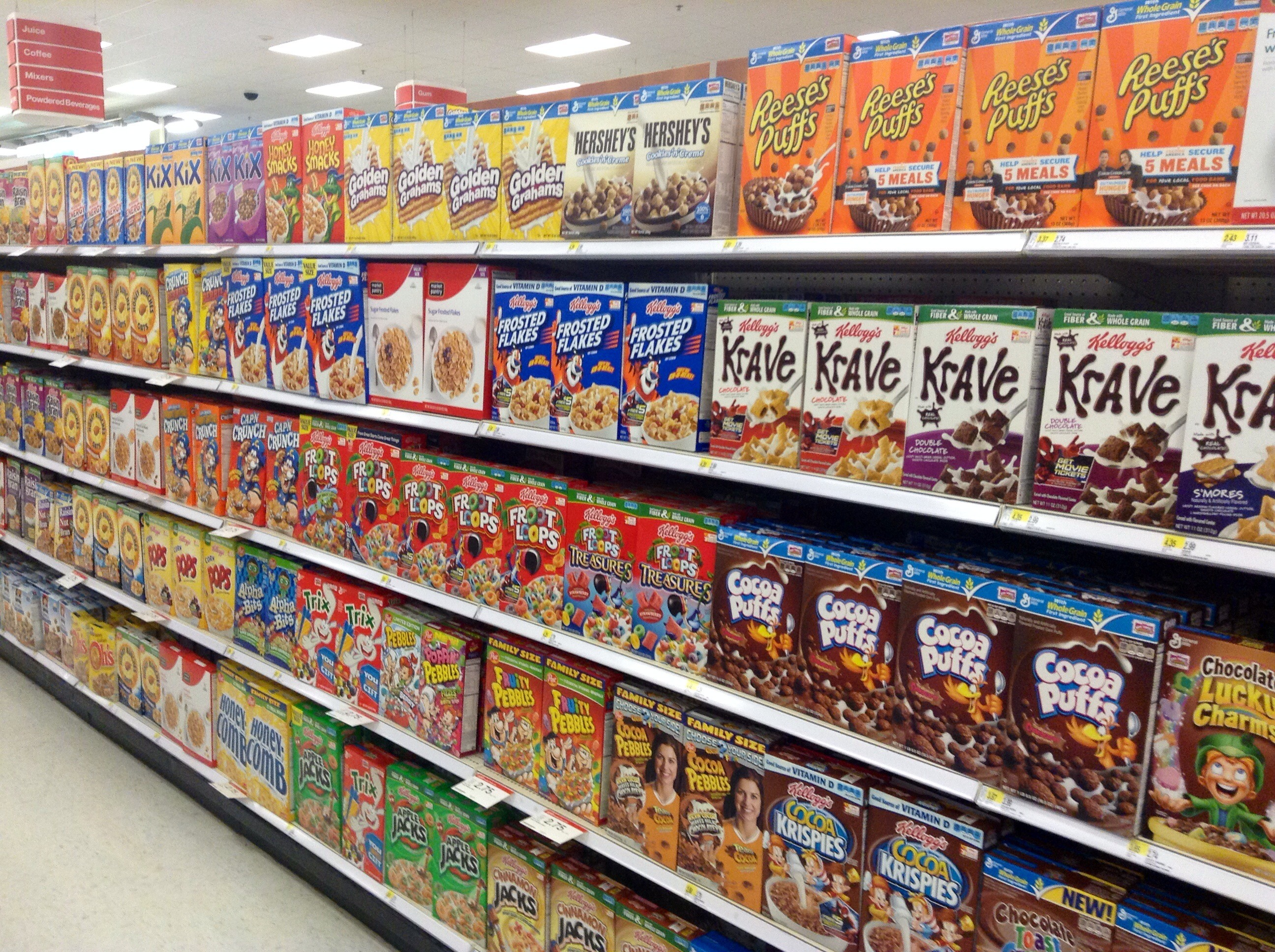 Breakfast cereals in aisle of supermarket.