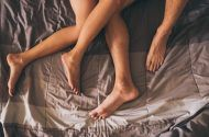 Man and woman's legs in bed