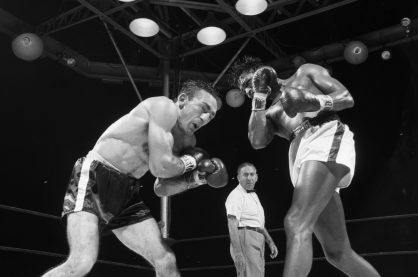 Two boxers in the ring in black and white.