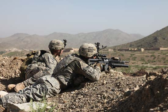 An image of two soldiers fighting in the war in Afghanistan