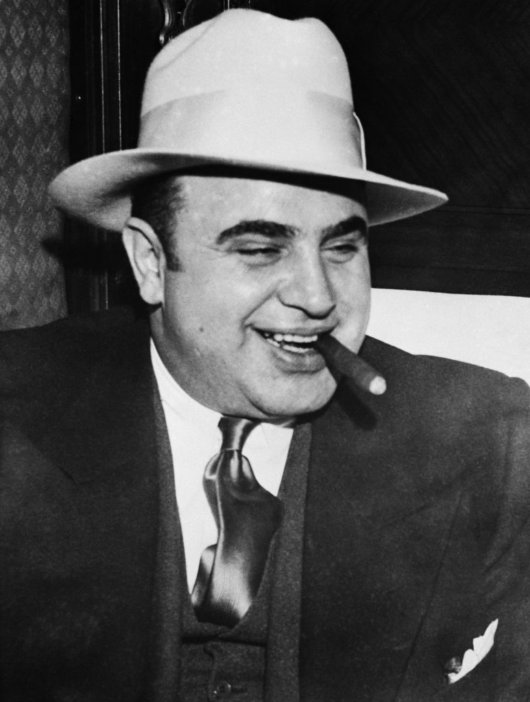 An image of Al Capone smoking a cigar