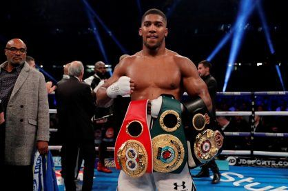 Anthony Joshua with his championship belts