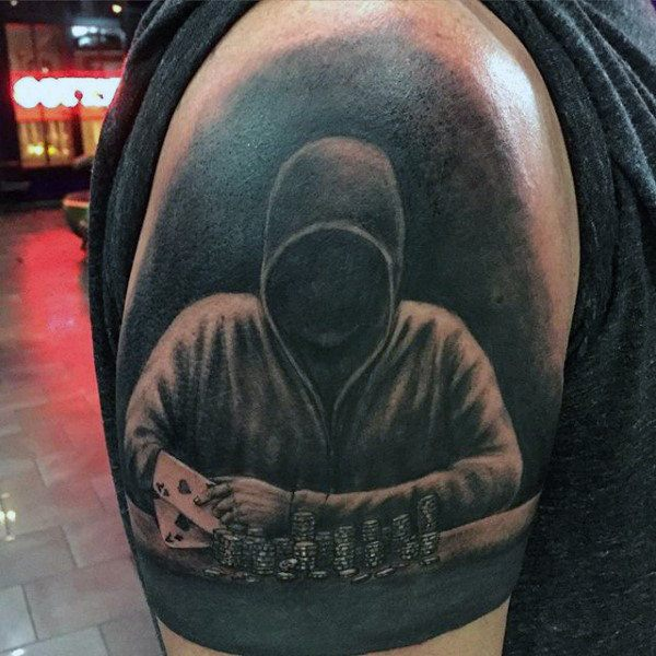 Arm tattoo of a hooded poker player
