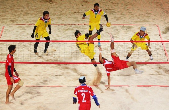 Sepak Takraw being played in a beach environment