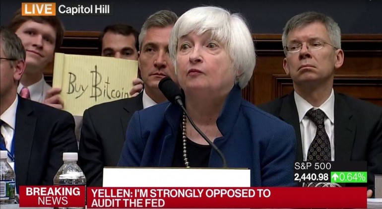 A photo of someone promoting Bitcoin as an American Economist speaks