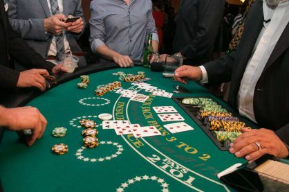 Some punters playing blackjack at a live casino