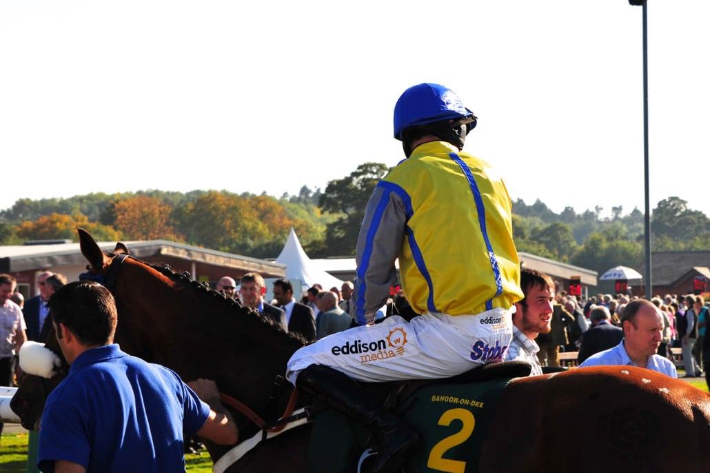 Jockey on horse.