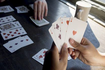 A photo of two people playing a game of cards