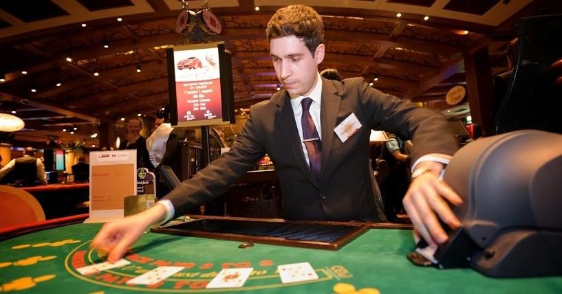 A blackjack dealer at a land-based casino