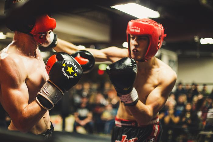 A photo of two Chess Boxers in action