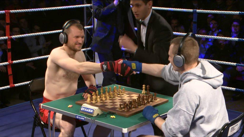 Both fighters shaking hands before a Chess Boxing match