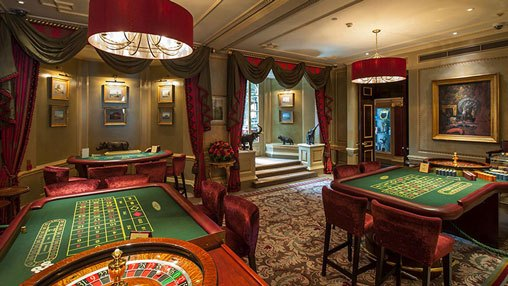 interior of Clermont Club shows gaming tables