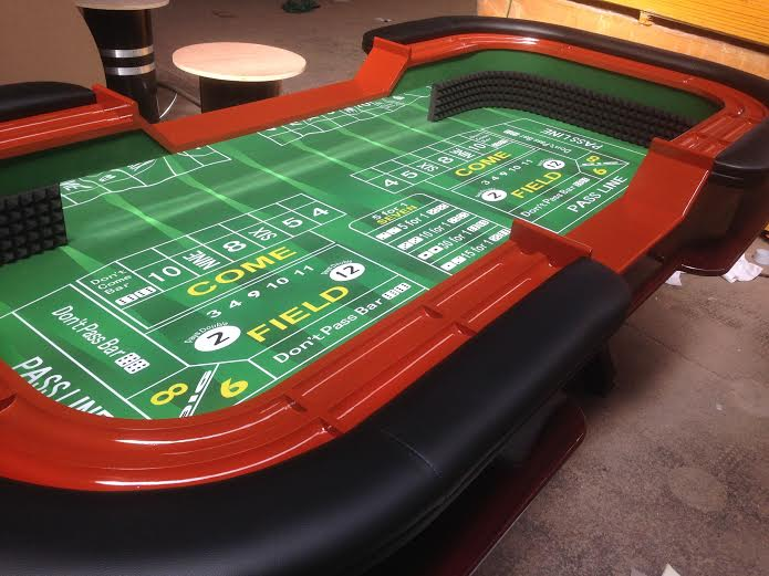 A craps table, one of the most popular dice games