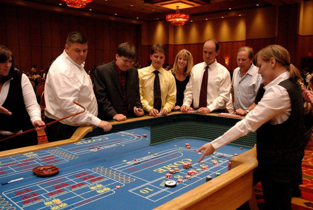 People playing the dice game; Craps
