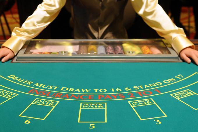 A blackjack croupier at a land-based casino