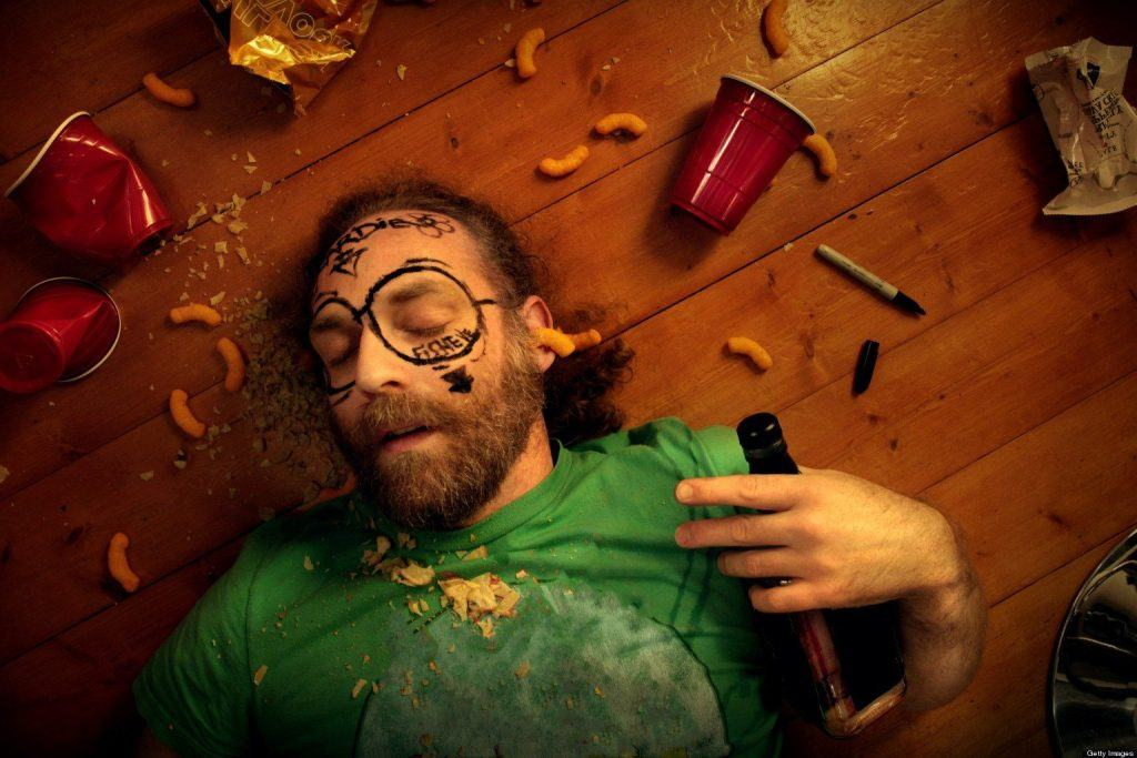 A typical example of a drunk patient, on a brown wooden background
