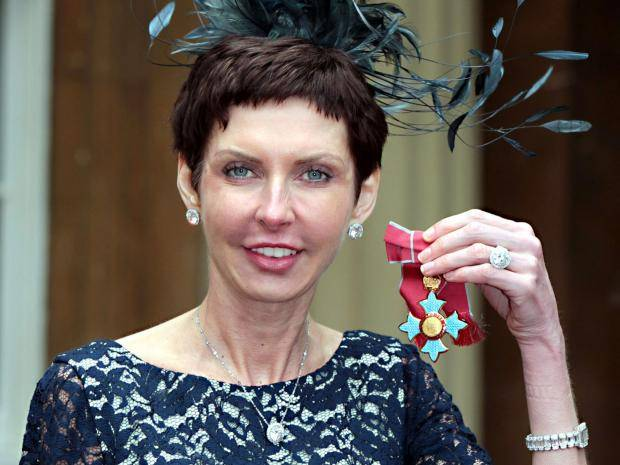 Denise Coates receiving her honour of Commander of the Order of the British Empire