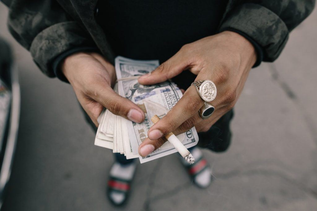 Someone with a roll of cash on hand