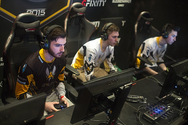 Three players competiting at a live Esports event