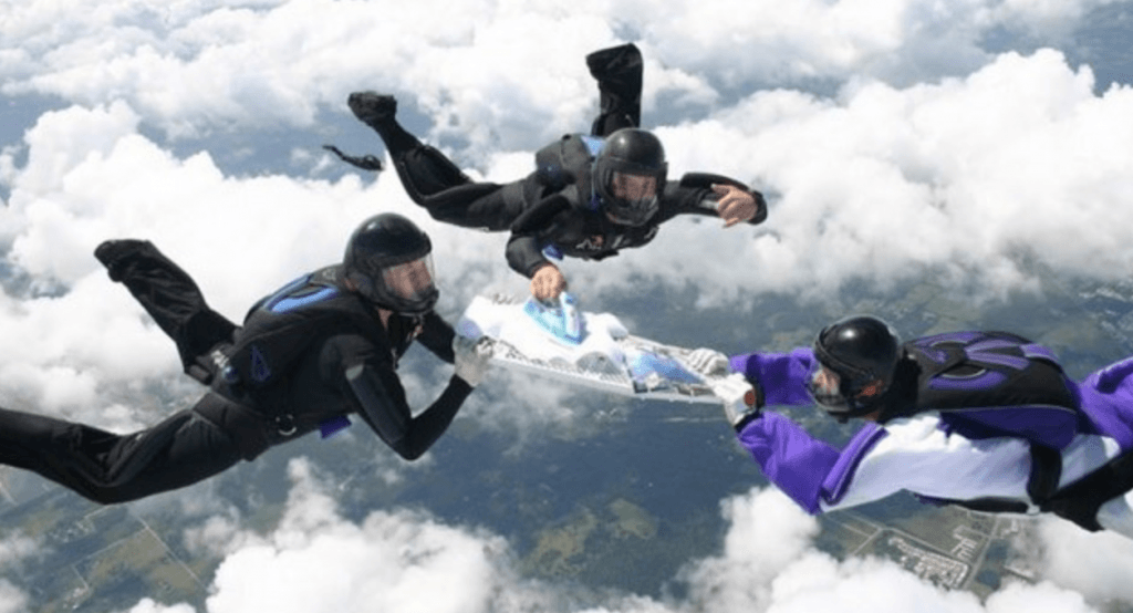 Extreme Ironing taking place whilst people skydive