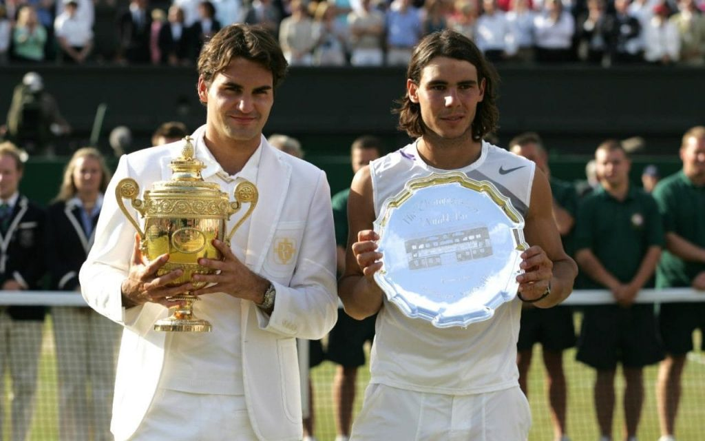 Federer and Nadal with their Wimbledon trophies