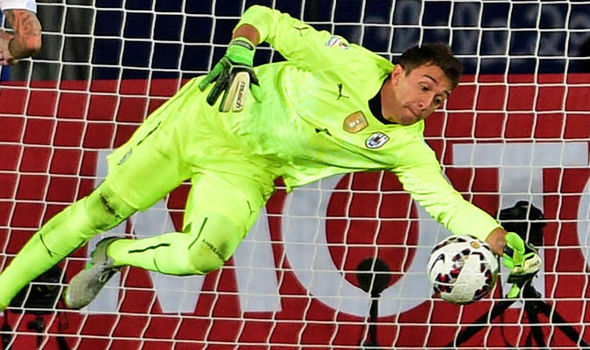 The Uruguayan goalkeeper, Fernando Muslera attempting to save a shot