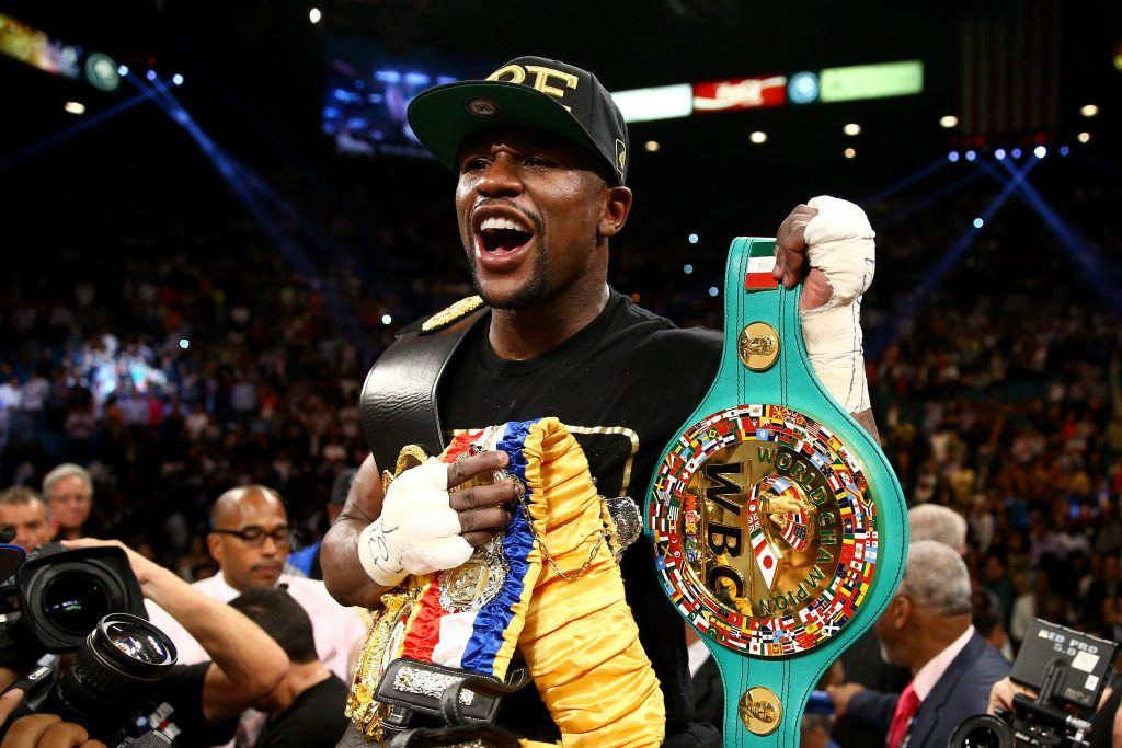 Floyd 'Money' Mayweather lifting a belt from a previous fight