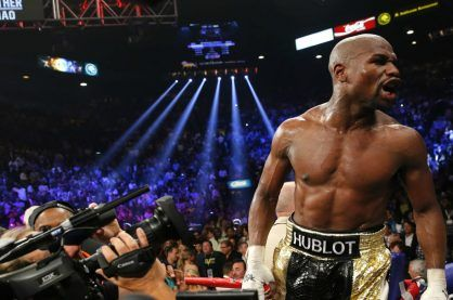 Floyd Mayweather celebrating after a fight