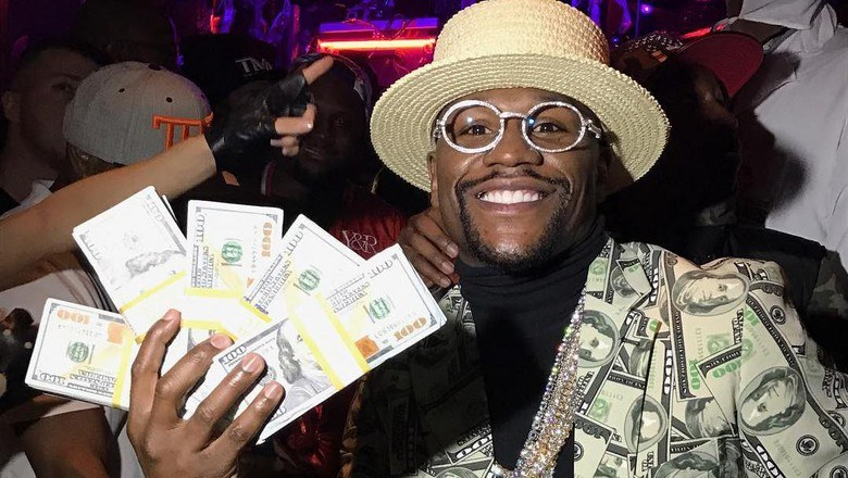 Floyd 'Money' Mayweather pictured flashing his wealth