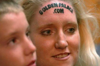 Women's GoldenPalace.com forehead tattoo