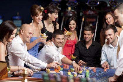 People enjoying a night out gambling at the casino