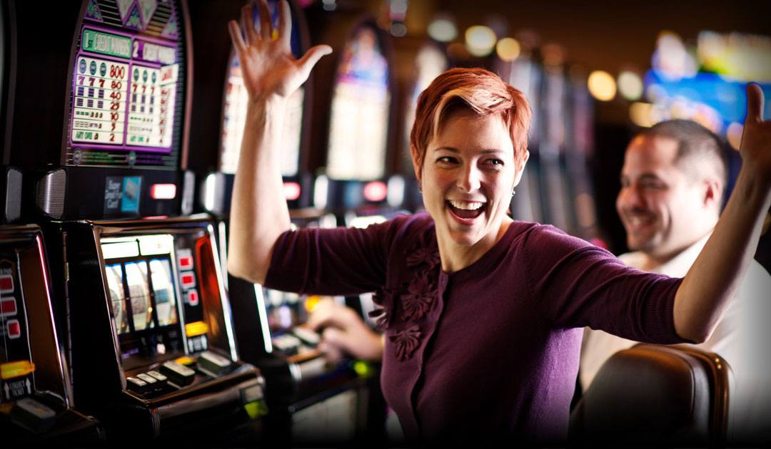 Someone gambling on a casino slot machine