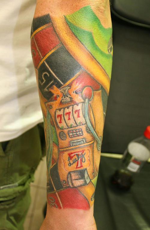 Multi-colored gambling sleeve tattoo