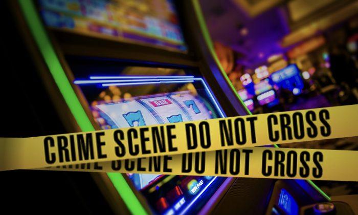 Crime scene taped across a slot machine cabinet