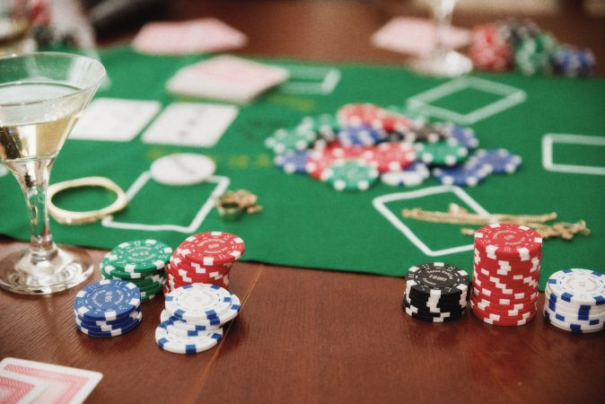 Playing chips on game table.