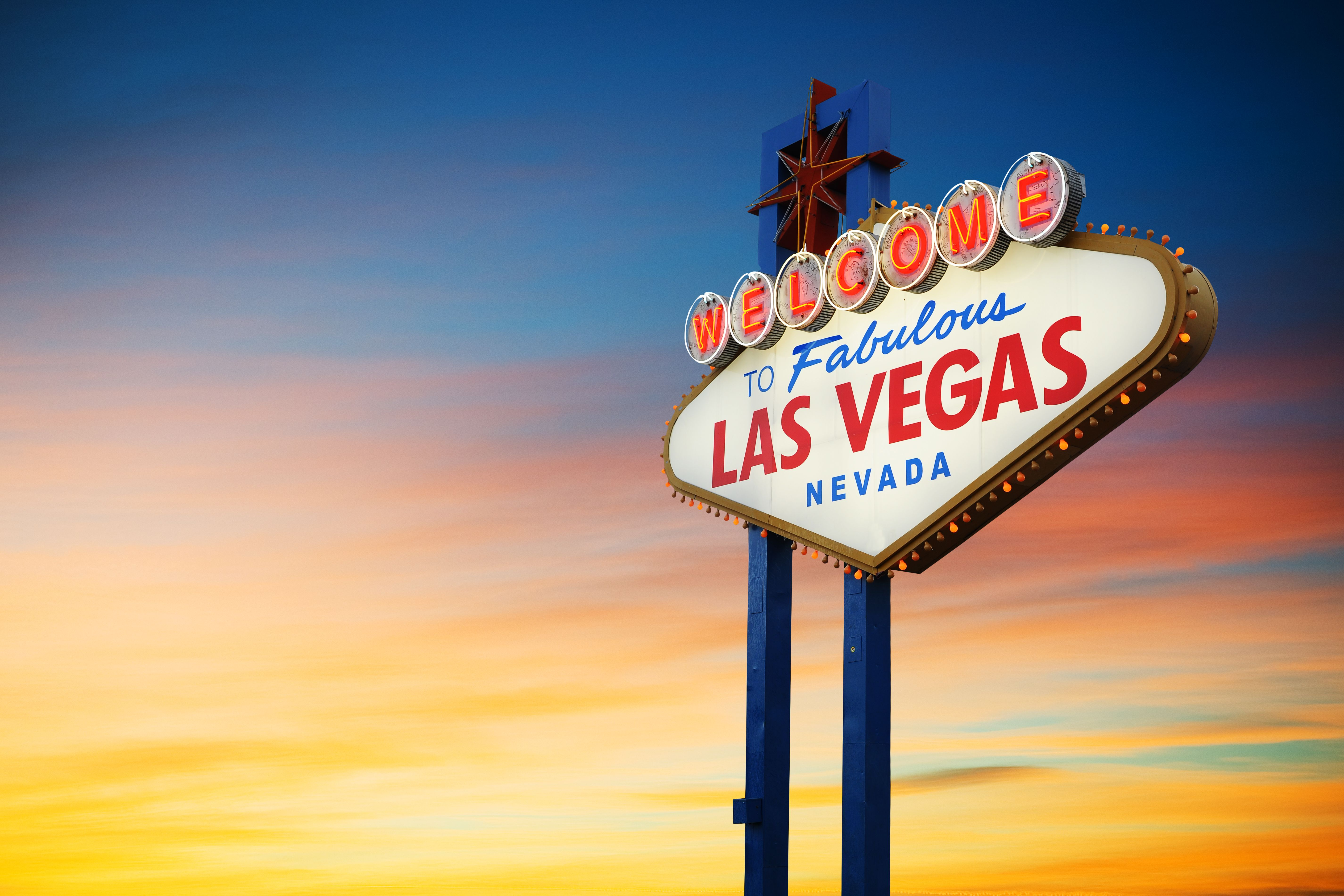 Welcome to Fabulous Las Vegas, Nevada Sign with sunset background