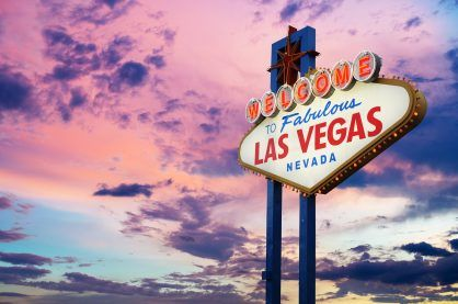 Welcome to Fabulous Las Vegas, Nevada Sign with sunset background.