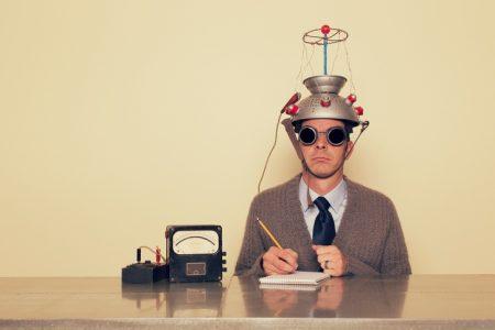 Man with brain testing equipment.