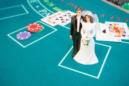 Bride and groom figurine on betting table