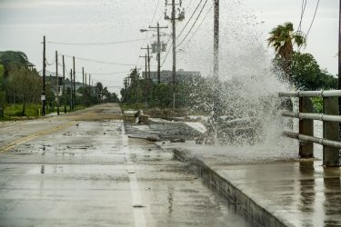 Water crashing over a road near Galveston Bay just outside of Houston Texas during Hurricane Harvey