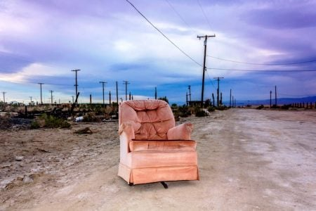 Old armchair outside in Salton City, California, United States.