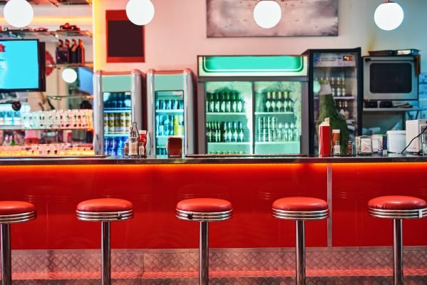 Cropped shot of bar stools in a retro diner.