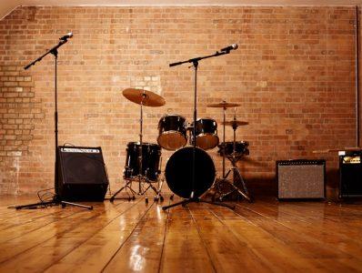 Drum Kit, Microphones and Loudspeakers in a Studio.
