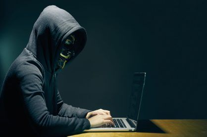 A stereotypical example of an online hacker