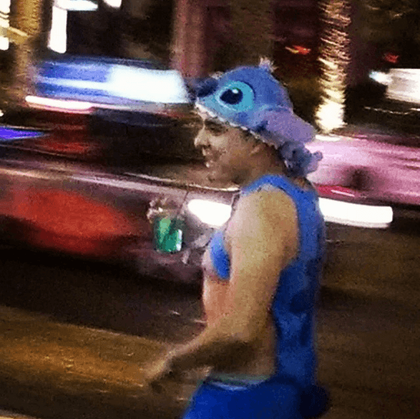 Someone drinking in a Disney carton characters outfit