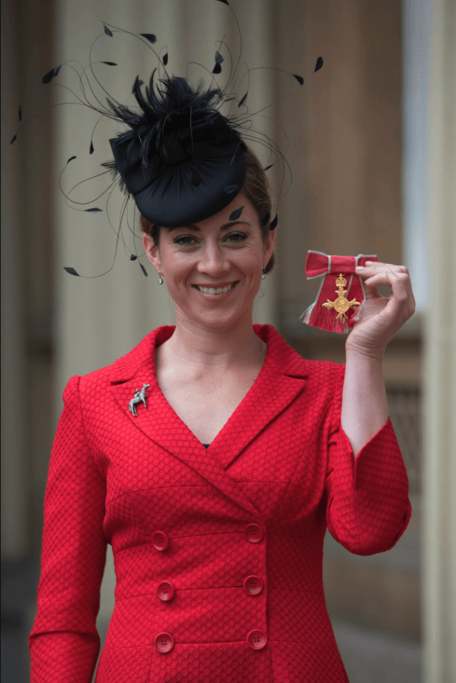 Hayley Turner posing with her OBE