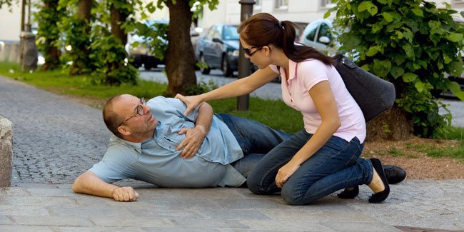 An image showing someone falling down suffering from a heart attack