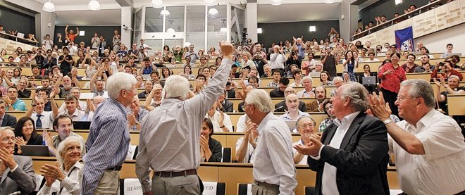 Physicists celebrating the higgs boson discovery