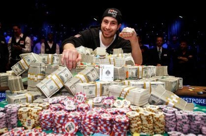 Duhamel pictured with the 2010 WSOP bracelet and prize money