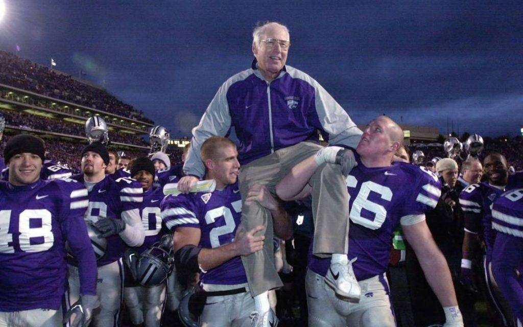 Kansas State players celebrating a famous win with their coach